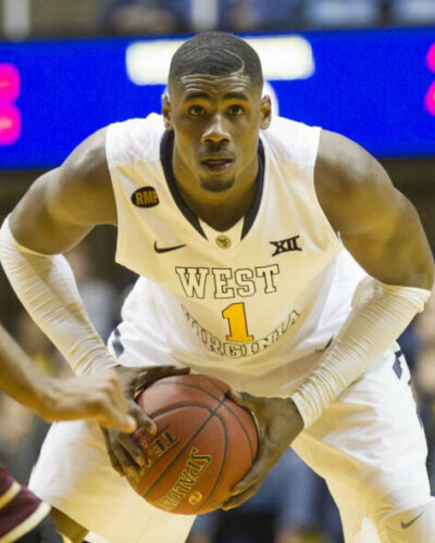 West Virginia Mountaineers forward Jonathan Holton looks for an open teammate against the College of Charleston Cougars during the send half at the WVU Coliseum.